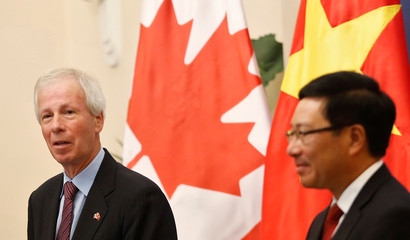 Canada's Foreign Minister Stephane Dion and Vietnam's Deputy Prime Minister and Foreign Minister Pham Binh Minh attend a press conference at the Government Guesthouse in Hanoi, Vietnam