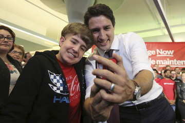 Liberal leader Trudeau takes a selfie during a campaign stop in Hamilton