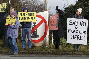 Demonstrators protest at a fracking test drilling site in Upton, near Chester in Britain