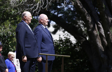 Norway's King Harald V and Australia's Governor-General Cosgrove listen to national anthems during an official welcome ceremony on the Lakeside Lawns of Government House in Canberra