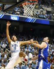 North Carolina Tar Heels Kendall Marshall is fouled by Creighton Bluejays Ethan Wragge during their NCAA basketball game in Greensboro, North Carolina