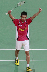 Malaysia's Lee Chong Wei celebrates upon getting a point against China's Chen Long during the men's singles semi-finals of Malaysia Open badminton tournaments in Kuala Lumpur