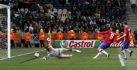 Serbia's Pantelic scores past Australia's goalkeeper Schwarzer during a 2010 World Cup Group D soccer match in Nelspruit