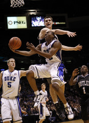 Duke's Smith Drives past Butler's Smith for basket in first  half of NCAA basketball game in East Rutherford