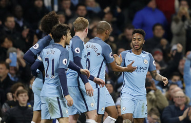 Manchester City's Raheem Sterling celebrates scoring their second goal with team mates
