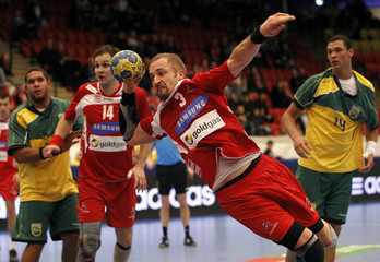 Austria's Folser tries to score against Brazil during their group B match at the Men's Handball World Championship in Norrkoping