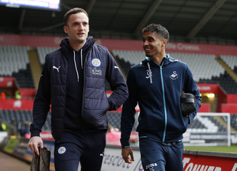 Leicester City's Andy King and Swansea City's Kyle Naughton before the match
