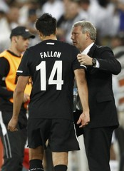 New Zealand's head coach Ricki Herbert speaks to Rory Fallon after Fallon is substituted during their 2010 World Cup Group F soccer match against Paraguay at Peter Mokaba stadium in Polokwane