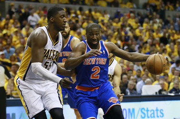 Knicks guard Felton drives on Indiana Pacers center Hibbert during the second half of an NBA Eastern Conference second round playoff basketball game in Indianapolis