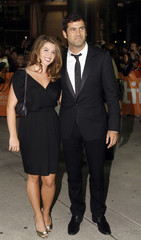 Director David Rosenthal and Julia Larson pose at a gala presentation during the 35th Toronto International Film Festival in Toronto