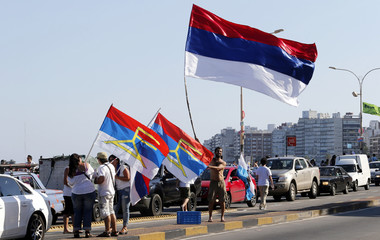 Supporters of Uruguayan ruling party Frente Amplio  rally by Montevideo's waterfront