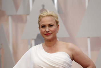 "Arquette, best supporting actress nominee for her role in ""Boyhood,"" arrives at the 87th Academy Awards in Hollywood"