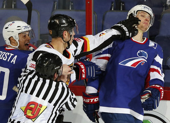 Germany's Ullmann punches France's Roussel during their 2013 IIHF Ice Hockey World Championship preliminary round match at the Hartwall Arena in Helsinki