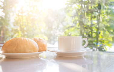 Cup of coffee with bread on the table.