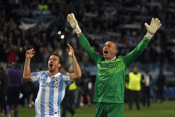 Malaga's goalkeeper Caballero and his teammate Camacho celebrate their victory over Porto following their Champions League match in Malaga