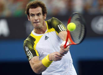 Murray of Britain hits a return to Dimitrov of Bulgaria during their men's final match at the Brisbane International tennis tournament