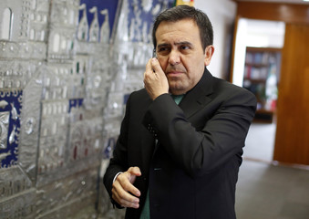 Mexican Economy Minister Ildefonso Guajardo listens during a phone call before an interview with Reuters at his office in Mexico City