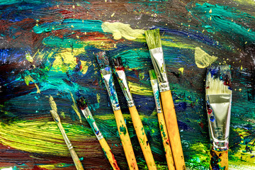 multicolored paint design with brushes for abstract texture background