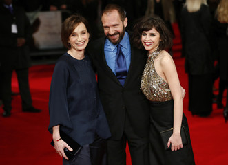 """Fiennes poses for photos with Jones and Scott-Thomas at the premiere of their film """"The Invisible Woman"""" at a cinema in Kensington"""