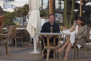 Britain's Prime Minister David Cameron and his wife Samantha pose for a photograph during their holiday in Playa Blanca, Lanzarote