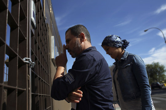 El Jaidi reacts as he finds property promoter's office locked and chained, in Madrid