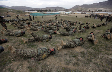 Commandos from the Afghan National Army take part in a military demonstration in Rishkhur district outside Kabul