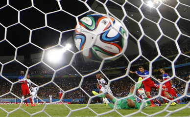 Ghana's Andre Ayew scores a goal during their 2014 World Cup Group G soccer match at the Dunas arena in Natal