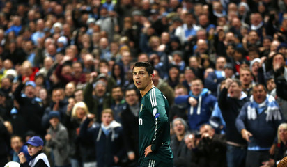 Manchester City fans react toward Real Madrid's Cristiano Ronaldo during their Champions League Group D soccer match at The Etihad Stadium in Manchester
