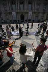 Musicians play their instruments during a protest by Association of Music Education and Culture (AMEC) in Lisbon