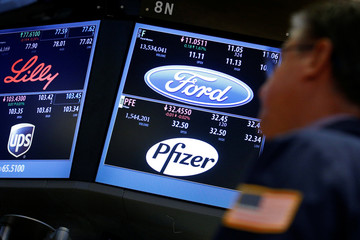 Trading info for UPS, Eli Lilly, Ford and Pfizer are displayed on screens on the floor of the NYSE in New York