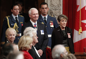 David Johnston and his wife Sharon stand as they wait for Johnston to be sworn-in as Canada's 28th Governor General in Ottawa