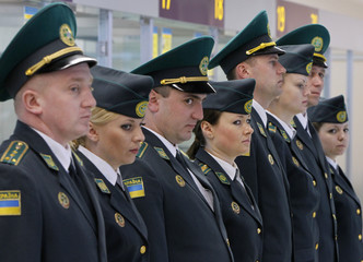 Ukrainian border guards are seen in a new terminal of Lviv International Airport in Lviv