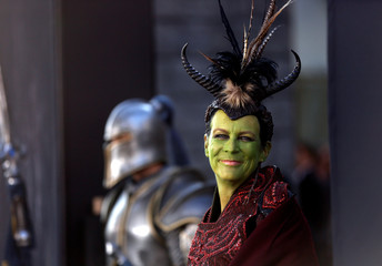 "Actress Curtis poses while wearing make-up and costume at the premiere of the movie ""Warcraft"" in Hollywood"