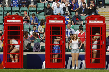 Cheerleaders change their outfits in red phone booths during performance before Heineken Cup final rugby match between Leinster and Ulster at Twickenham Stadium in London