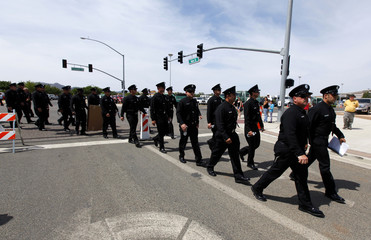 Firefighters from Los Angeles arrive at a memorial for the fallen members of the Prescott Fire Department's Granite Mountain Hotshots team in Prescott