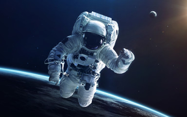 Wall Mural - Astronaut in deep space. Elements of this image furnished by NASA