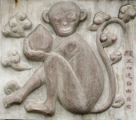A photo shows a relief of a monkey as one of Chinese zodiac signs at the Bai Yun Guan or White Cloud Temple in Beijing