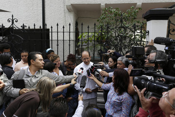 Mexican Catholic priest Alejandro Solalinde speaks to the media outside the Honduras embassy in Mexico City