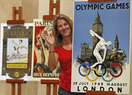 British artist Tracey Emin poses with vintage Olympic posters at Tate Britain in London