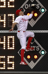 Phillies right fielder Pence mishandles a fly ball from the Dodgers during the third inning of their National league MLB baseball game in Philadelphia Pennsylvania