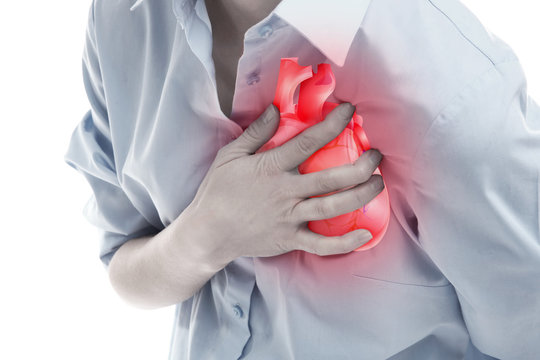 Heart attack concept. Young woman suffering from chest pain on white background