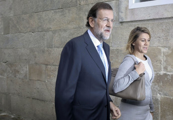 Spain's main opposition Popular Party leader Mariano Rajoy and Secretary-General Maria Dolores de Cospedal arrive at the Popular Party's national executive committee in Santiago de Compostela