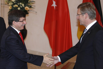 German President Wulff and Turkey's Foreign Minister Davutoglu shake hands before talks in Berlin