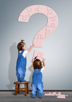 Kids question concept. Little childrens made question mark from puzzle