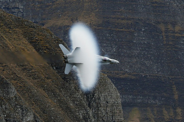 A Swiss Air Force F18 fighter jet performs during a flight demonstration of the Swiss Air Force over the Axalp
