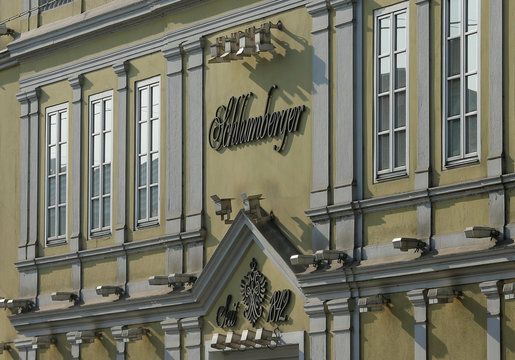 The logo of Austrian sparkling wine maker Schlumberger is seen above the entrance of its headquarters in Vienna