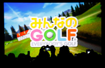 A man takes a photo of the logo of Sony's 'Everybody's Golf' during ForwardWorks Beginning event in Tokyo