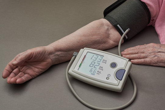 Senior woman is taking care for health with heart beat monitor and blood pressure
