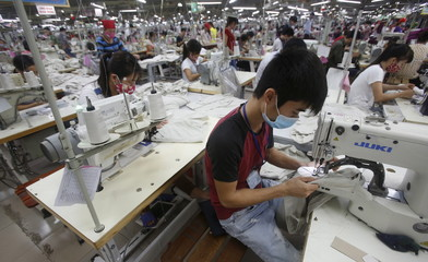 Labourers work at a garment factory in Bac Giang province, near Hanoi