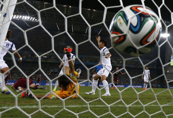 South Korea's goalkeeper concedes a goal by Jung Sung-ryong Russia's Alexander Kerzhakov during their 2014 World Cup Group H soccer match at the Pantanal arena in Cuiaba